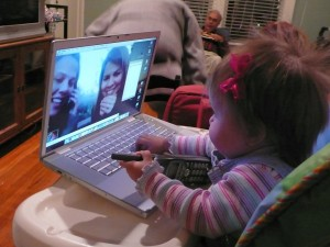 child talking to parents via video conferencing- Sadies 1st video conf- 2036640878_66a505d2fe_b
